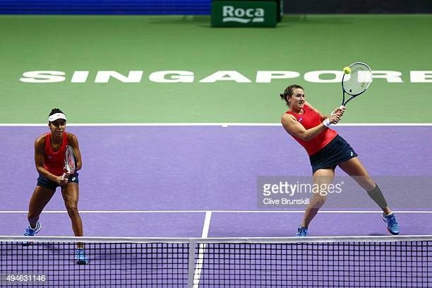 Raquel KopsJones and Abigail Spears of the USA in action against Timea Babos of Hungary and Kristina Mladenovic of France in a doubles round robin...