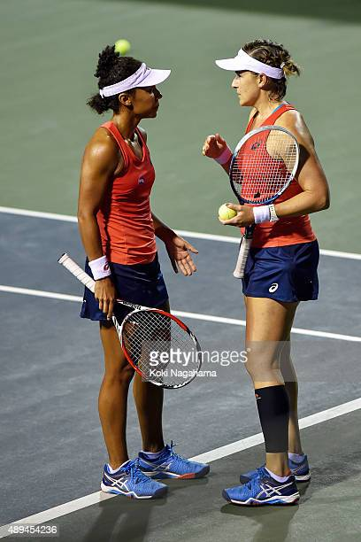 Raquel KopsJones and Abigail Spears of the USA in action during their women's doubles match against Misaki Doi and Kurumi Nara during day one of the...