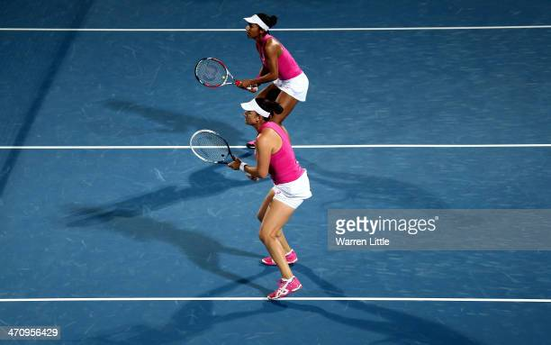 Raquel KopsJones and Abigail Spears of the USA side by side against Flavis Pennetta of Italy and Samatha Stsur of Australia during the doubles semi...