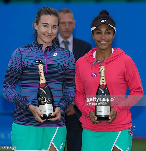 Raquel KopsJones and Abigail Spears of USA are presented with Moet Champagne after their victory against Jocelyn Rae and Anna Smith of Great Britain...