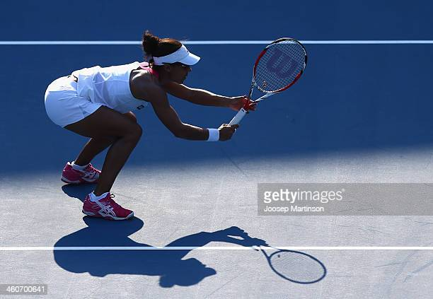 Raquel KopsJones of the United States in action in their first round match against Svetlana Kuznetsova and Ekaterina Makarova of Russia during day...
