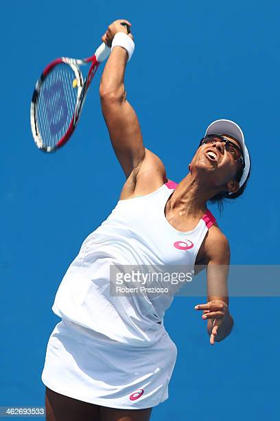 Raquel KopsJones of the United States serves in her first round doubles match with Abigail Spears of the United States against ChiaJung Chuang of...