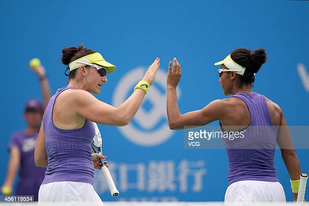 Raquel KopsJones of USA and Abigail Spears of USA compete against Martina Hingis of Switzerland and Flavia Pennetta of Italy during day six of the...