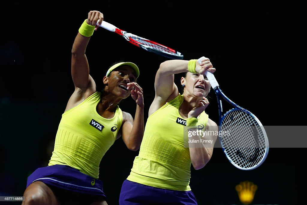 Raquel Kops-Jones of USA and Abigail Spears of USA go for the same ball in the doubles quarter finals against Cara Black of Zimbabwe and Sania Mirza of India during day four of the BNP Paribas WTA Finals tennis at the Singapore Sports Hub on October 23, 2014 in Singapore.