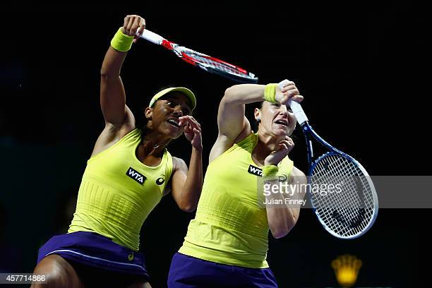 Raquel KopsJones of USA and Abigail Spears of USA go for the same ball in the doubles quarter finals against Cara Black of Zimbabwe and Sania Mirza...