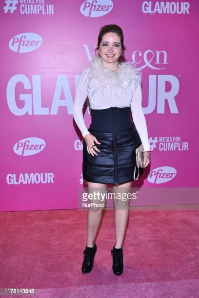 Raquel Ortigoza poses for photos during the pink carpet of 'Vive con Glamour' to promote prevention of breast cancer at Terminal 1 Sinaloa on October...