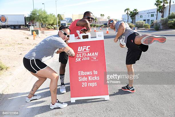 Raquel Pennington and John Dodson host an exercise station during the UltiMan 5K event at Town Square on July 9 2016 in Las Vegas Nevada