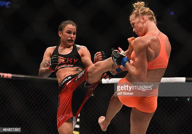 Raquel Pennington kicks Holly Holm in their women's bantamweight bout during the UFC 184 event at Staples Center on February 28 2015 in Los Angeles...