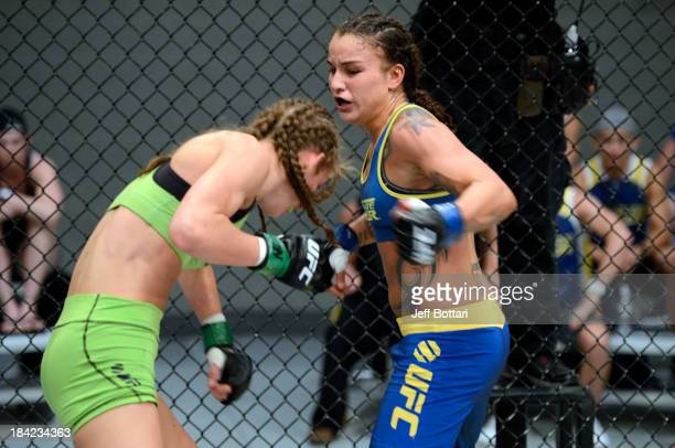 Raquel Pennington punches Jessamyn Duke in their preliminary fight during filming of season eighteen of The Ultimate Fighter on June 17, 2013 in Las...