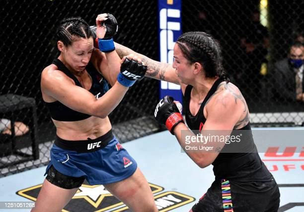 Raquel Pennington punches Marion Reneau in their bantamweight bout during the UFC Fight Night event at UFC APEX on June 20 2020 in Las Vegas Nevada
