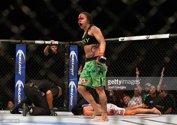 Raquel Pennington reacts to her victory over Ashlee EvansSmith in their women's bantamweight bout during the UFC 181 event inside the Mandalay Bay...