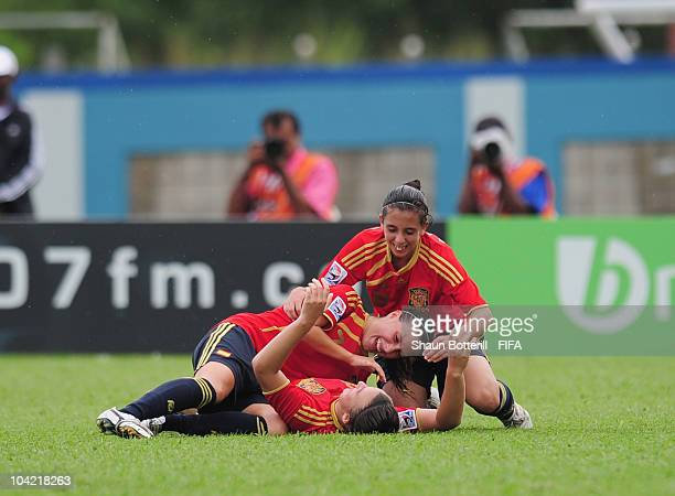Raquel Pinel of Spain is congratulated by teammates after scoring during the FIFA U17 Women's World Cup Quarter Final match between Spain and Brazil...