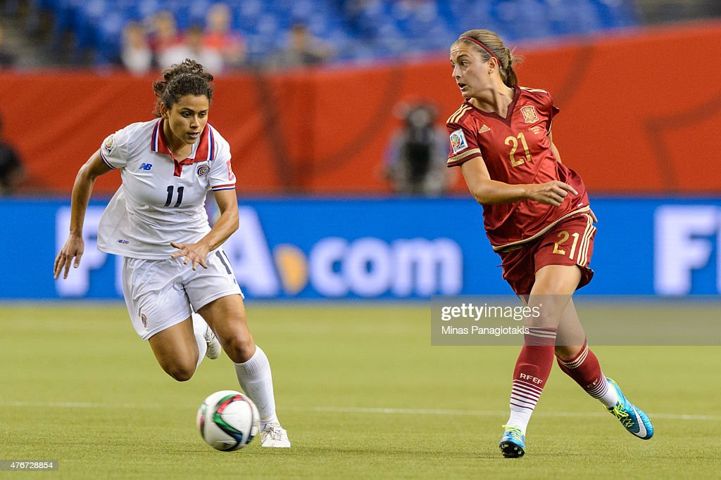Raquel Rodriguez Cedeno #11 of Costa Rica and Alexia Putellas #21 of Spain chase the ball during the 2015 FIFA Women's World Cup Group E match at Olympic Stadium on June 9, 2015 in Montreal, Quebec, Canada. The final score between Spain and Costa Rica 1-1.