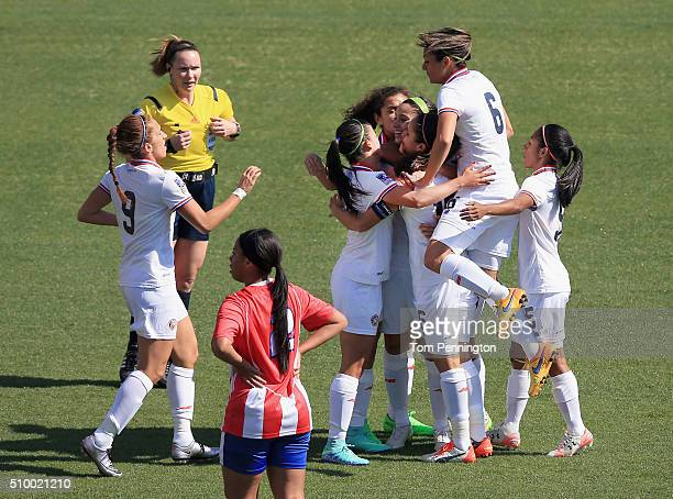Raquel Rodriguez celebrates with Karla Villalobos of Costa Rica and Carol Sanchez of Costa Rica after scoring a goal agaiinst Puerto Rico in the...