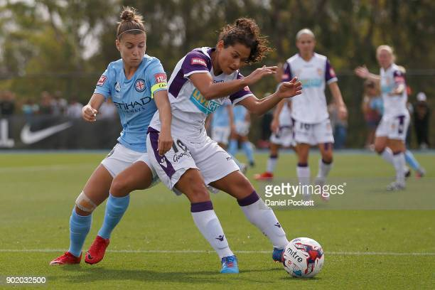 Raquel Rodriguez of Perth Glory and Stephanie Catley of Melbourne City contest the ball during the round ten WLeague match between Melbourne City and...