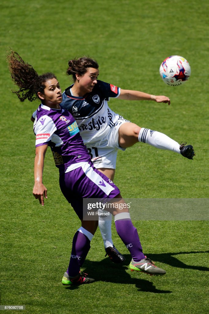 Raquel Rodriguez of the Glory and Christina Gibbons of the Victory compete for the ball during the round four W-League match between Perth Glory and Melbourne Victory at nib Stadium on November 19, 2017 in Perth, Australia.