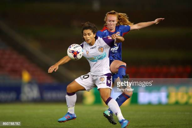 Raquel Rodriguez of the Glory and Victoria Huster of the Jets contest the ball during the round eight WLeague match between the Newcastle Jets and...