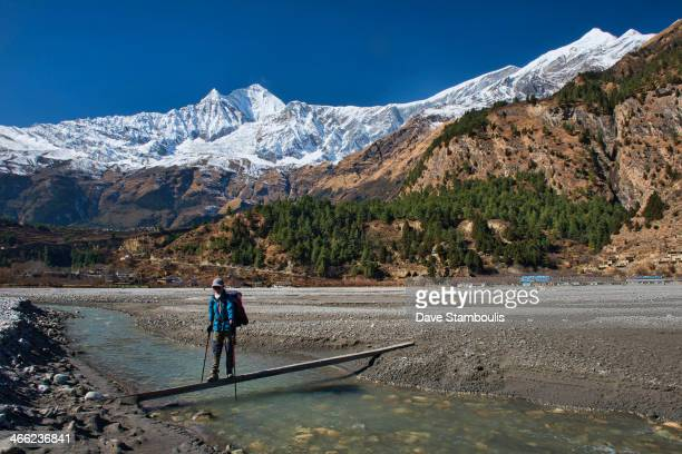 Raquel trekking along the Kali Gandaki River under the Dhaulagiri Range in the Annapurna area of Nepal