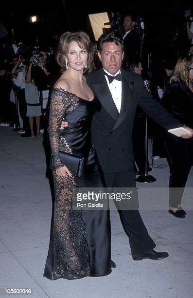 Raquel Welch and Richard Palmer during 1998 Vanity Fair Oscar Party Arrivals at Morton's Restaurant in Beverly Hills California United States
