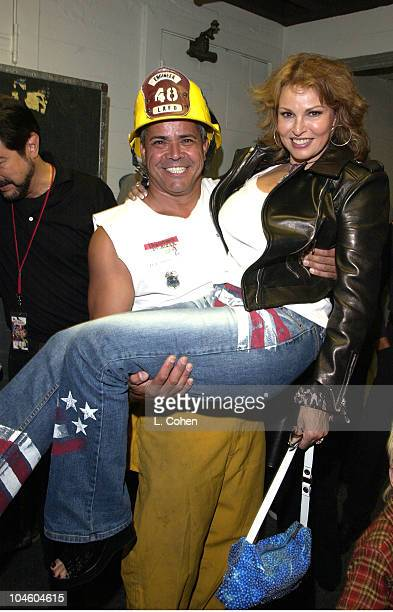 Raquel Welch gets a helping hand from Anthony Morales of the Los Angeles Fire Department backstage at the Chicago concert As a show of support for...