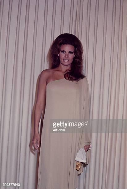 Raquel Welch in a beige evening dress circa 1970 New York