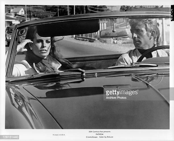 Raquel Welch in passenger sit of car in a scene from the film 'Fathom' 1967