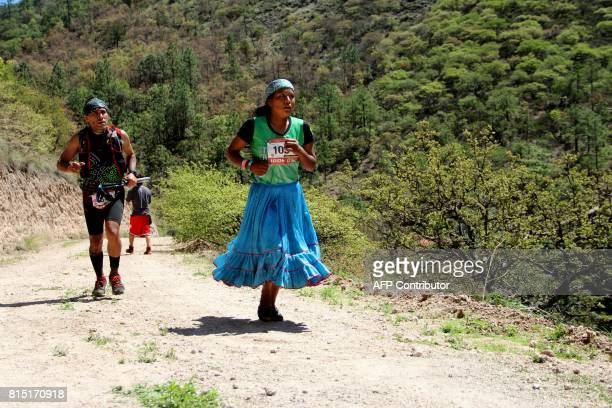 A Raramuris indigenous woman takes part in the Ultra maraton de los Canones 2017 at La Sinforosa Canyon in Guachochi Chihuahua state Mexico on July...