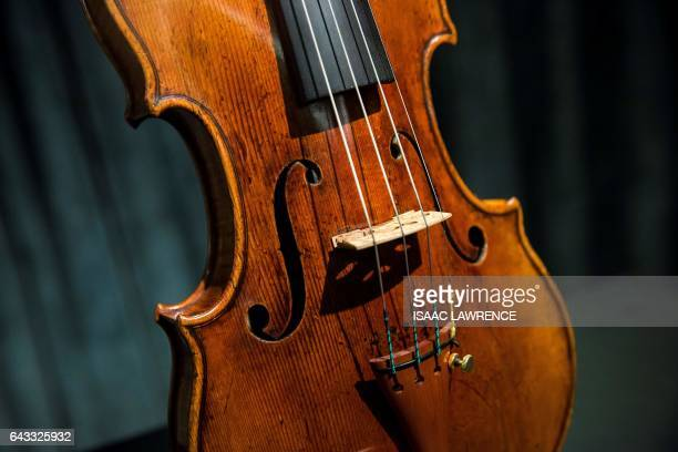 A rare 1684 violin by Antonio Stradivari is displayed during a media preview at Sotheby's in Hong Kong on February 21 ahead of the violin's auction...