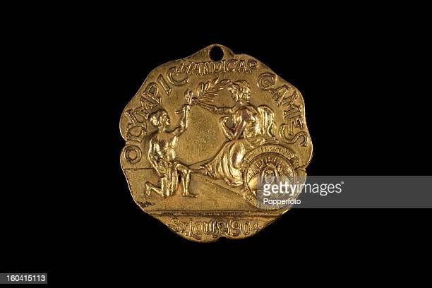 A rare 1904 St Louis Olympic Games 3rd place bronze prize medal for the 440 yards handicap swim won by Marquard Schwarz of the United States It is...
