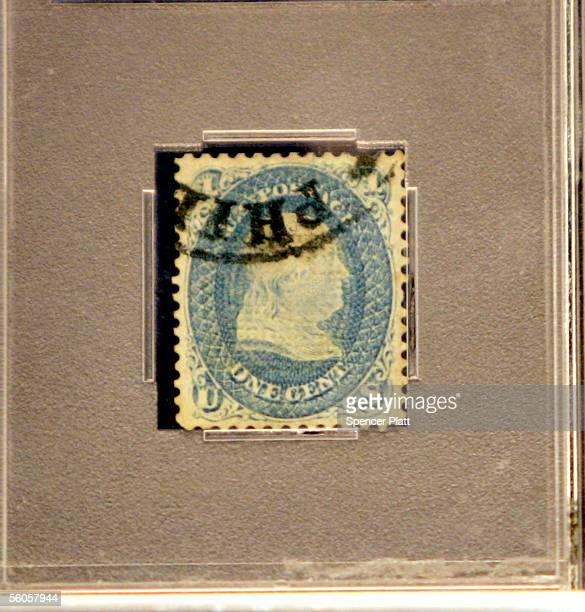 A rare 1cent Zgrill stamp depicting Benjamin Franklin that was issued in 1868 and named because of an experimental security grill is displayed before...