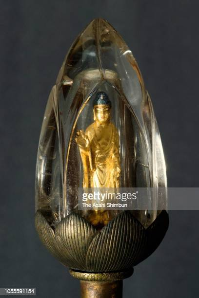A rare Amida Nyorai statue placed in a lotus flower budshaped crystal on display at Daigoji temple on October 15 2018 in Kyoto Japan A small...