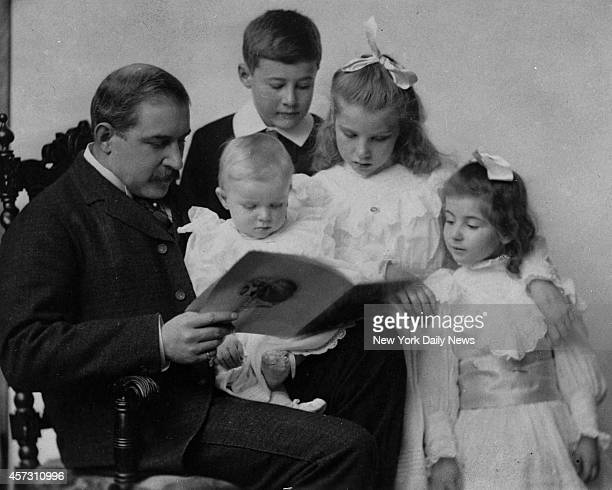 A rare and early foto of J P Morgan showing the financier with his children In his arms is Henry Sturges Morgan now a lieutenant commander in the...