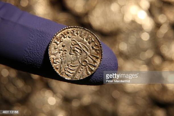 A rare Anglo Saxon silver penny is displayed at The British Museum on February 10 2015 in London England Rare coins and other finds are being shown...