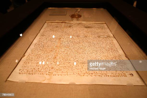 A rare copy of the Magna Carta is on display before it is auctioned off at Sotheby's New York to a phone bidder for $19 million December 18 2007 in...