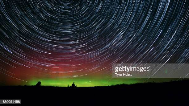 rare desert aurora night sky star trails over oregon - steens mountain stock pictures, royalty-free photos & images