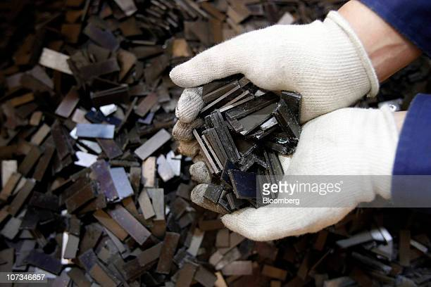 Rare earth magnets recovered from the magnetic rotors of discarded compressors are displayed for a photograph at Hitachi Plant Technologies Ltd's...