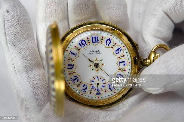 A rare example of an eightenn carat gold enamel ruby and diamond chronometer watch made specially for the Emperor Menelik II of Ethiopia is displayed...