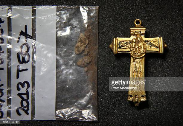 A rare gold reliquary cross dating from the 1718th century is displayed with possible relic remains at The British Museum on February 10 2015 in...