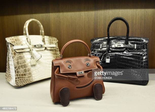 A rare Hermes 25 cm matte white Himalayan Nilo crocodile Brikin bag with palladium hardware an Hermes limited edition Noisette Gulliver leather...