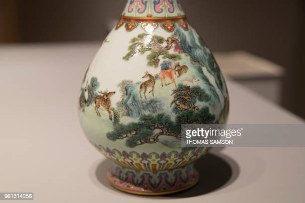 A rare Imperial Qianlong porcelain vase is displayed at Sotheby's auction company in Paris on May 22 2018 The vase which was stored in a shoebox in...