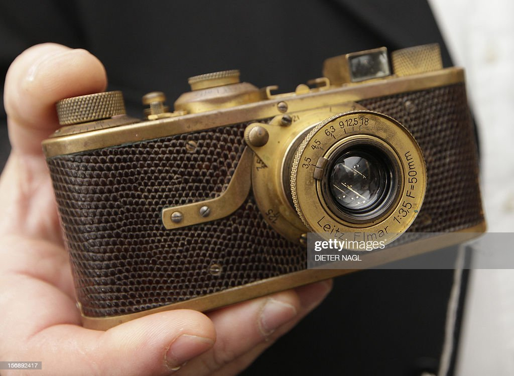 a rare leica i luxus gold plated camera dated 1929 is hold during an
