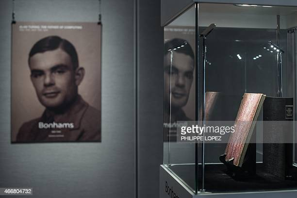A rare manuscript belonging to British mathematician and code breaker Alan Turing is displayed in Hong Kong on March 19 2015 The handwritten notebook...