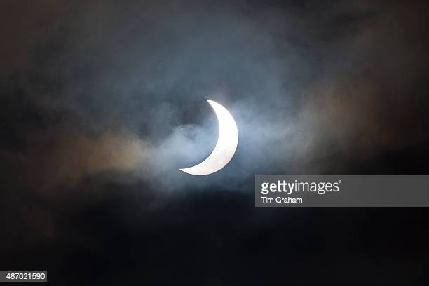 A rare partial solar eclipse is seen at 0946 over Burford on March 20 2015 in the Cotswolds United Kingdom The solar eclipse which occurs when the...