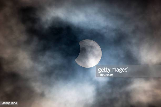 Rare partial solar eclipse is seen at 10.23 over Burford on March 20, 2015 in the Cotswolds, United Kingdom. The solar eclipse, which occurs when the...