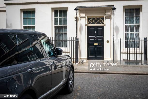Rare ray of sunshine hits the main front door of number 11 Downing Street, the home of the chancellor of the exchequer on the 25th of May 2021 in...