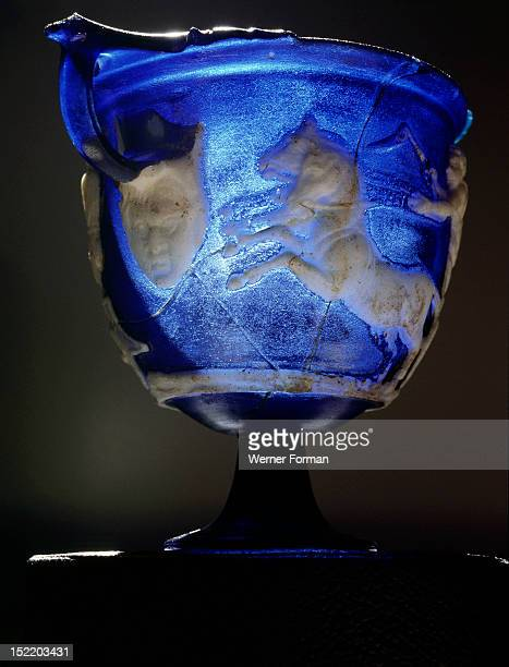 Rare Roman blue glass cameo carved skyphos depicting a scene from a Greek chariot race Scholars have suggested it may represent the Dionysiac games...