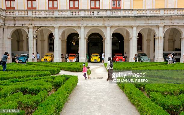 Rare special Citroen model cars are displayed inside the Royal Palace of Mafra during the World 2017 2CV Meeting July 30, 2017. - The event is held...