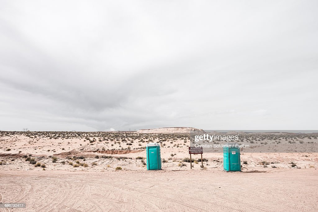 Rare View Of Portable Toilets In Front Of A Dune On Beach Against Sky : ストックフォト