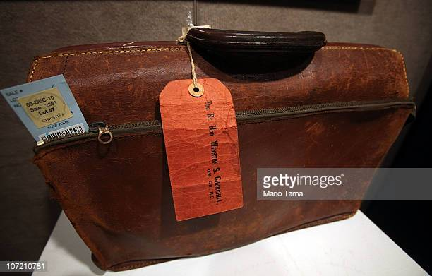A rare Winston Churchill leather briefcase estimated at $3000$5 is displayed at a press preview for the Fine Printed Books and Manuscripts including...