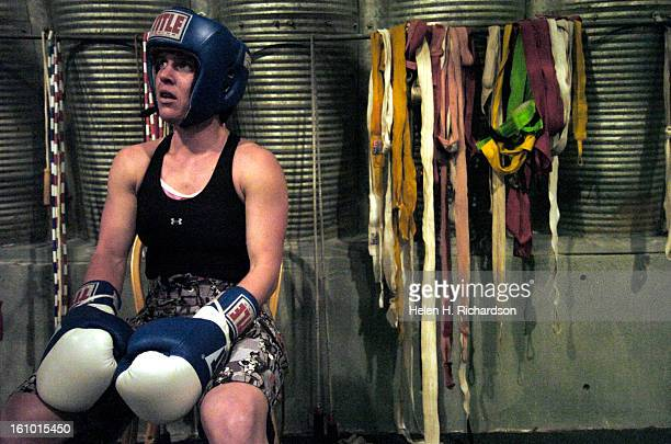 CO A rarity in the field Heather Schmitz <cq> is one of few female boxers <cq>pondering entering into the arena of professional boxing She had been a...